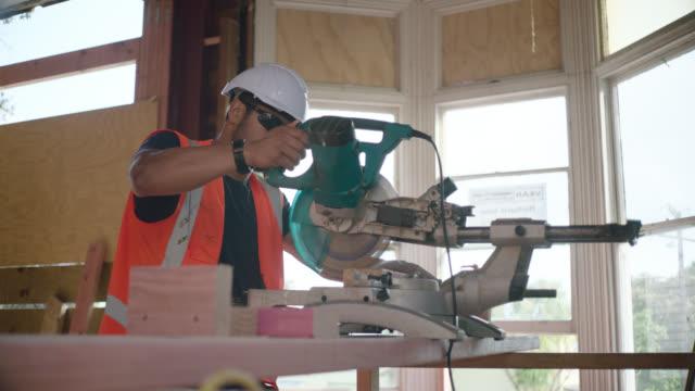 Builders operates circular saw
