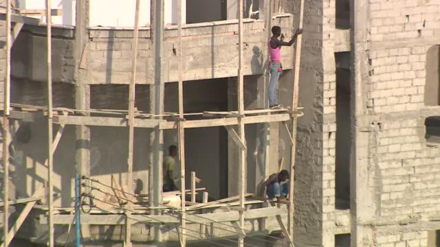Builders repairing damaged buildings in Mogadishu Somalia