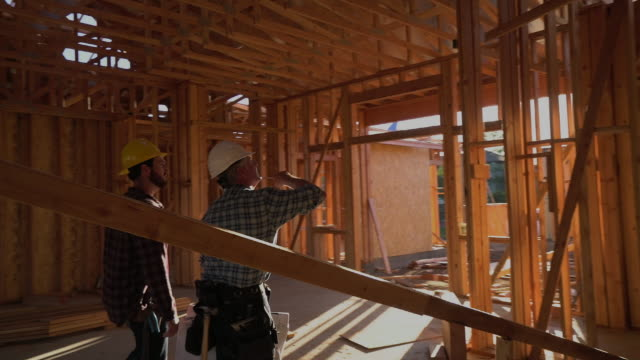 WS TS Builders walking through a house being built