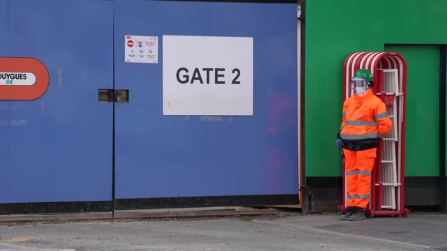 builders wear ppe face mack and shield get back to work on a site in east london after the prime minister announced the general contours of a phased... - pedestrian walkway stock videos & royalty-free footage