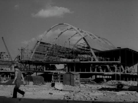 builders work on one of the exhibition halls at the festival of britain site on the south bank of the thames - festival of britain stock videos & royalty-free footage