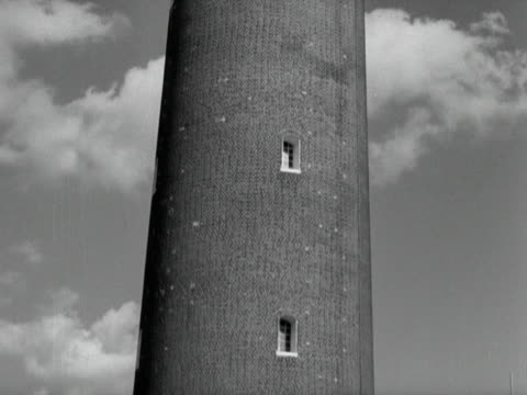 builders work on the moon message apparatus on top of the shot tower at the festival of britain site on the south bank of the thames - festival of britain stock videos & royalty-free footage