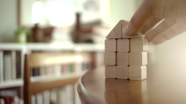 vídeos de stock, filmes e b-roll de building a house from wooden building blocks - stack