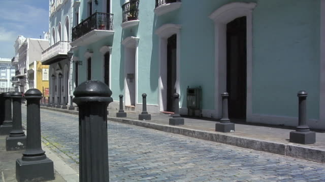 ms tu building at narrow street of calle de la fortaleza, old san juan, puerto rico, usa - narrow stock videos and b-roll footage