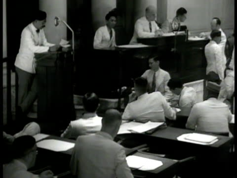 stockvideo's en b-roll-footage met building batavia. int indonesian parliament members in session. delegate talking at microphone. vs delegates sitting listening smoking cigarettes.... - parliament building
