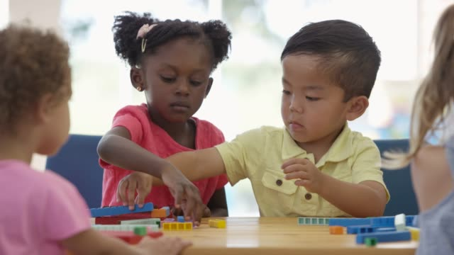 building blocks together in preschool - toy block stock videos and b-roll footage