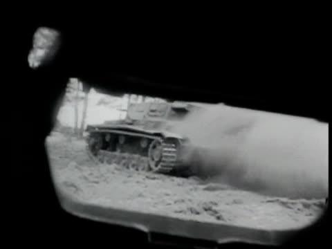 building burning fg w/ infantry running bg. german tank driving up to disabled smoking german nazi tank moving up to anti-tank guns firing... - tank stock videos & royalty-free footage