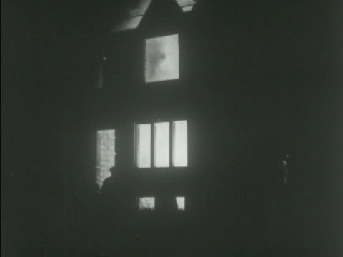 building burning inside windows door in silhouette w/ fire smoke interior *ms nazi german soldier w/ military police jager collar patches looking... - 1938 stock-videos und b-roll-filmmaterial