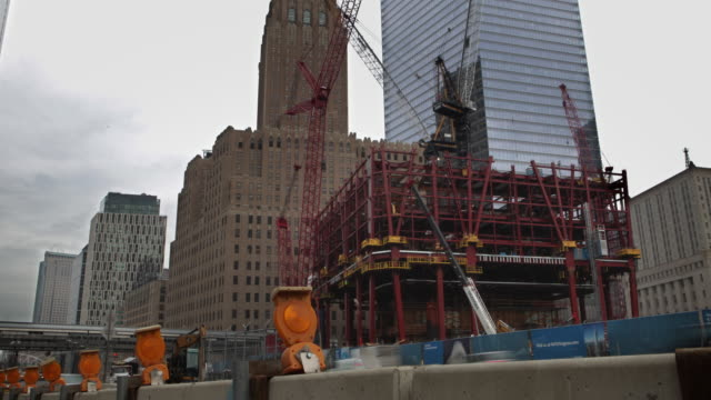 ws tu t/l building construction near world trade center site in new york city, traffic in foreground  / new york city, new york, usa - construction stock videos & royalty-free footage