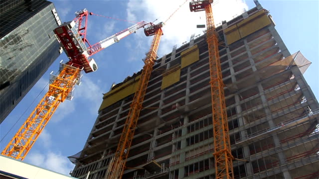 Building construction with the tower cranes
