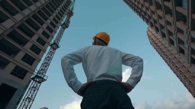 building contractor looking up in construction site - looking up stock videos & royalty-free footage
