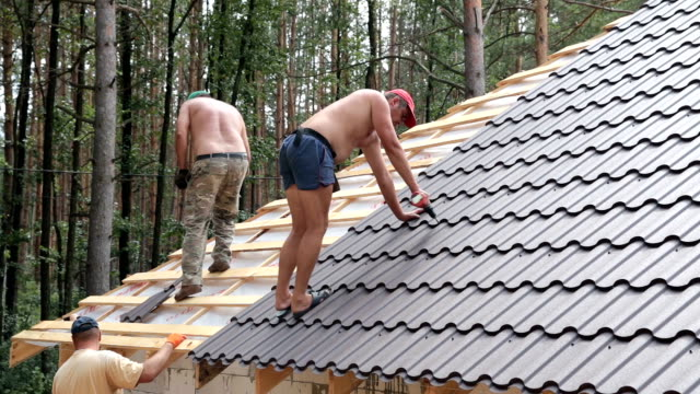 Building contractors are building a roof.