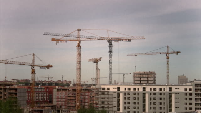 building cranes in stockholm sweden. - construction site stock videos & royalty-free footage
