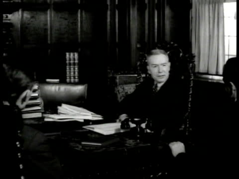 building directory 'rockefeller office of the messrs' ms john d rockefeller jr sitting at desk talking to men ext ws trees buildings philanthropist... - 1937 stock-videos und b-roll-filmmaterial