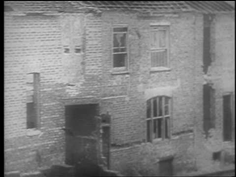 vidéos et rushes de building exploding from bomb / london blitz / educational - 1940