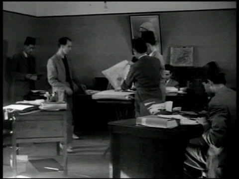 building int newspaper office w/ men wearing fez hats looking over daily paper some columns w/ editorial markings french official censorship - 1951 stock videos and b-roll footage