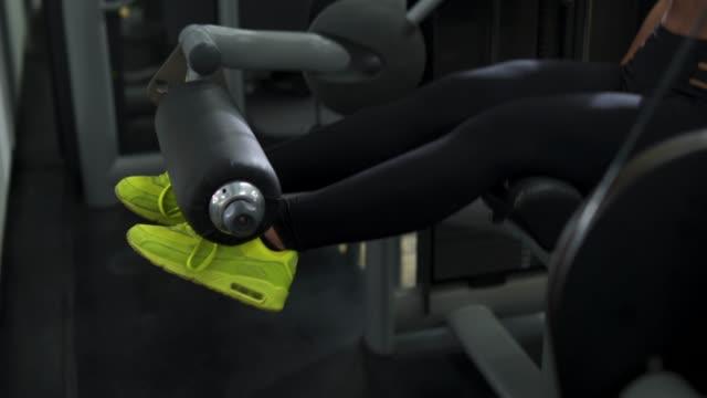 building leg muscles - leg press stock videos & royalty-free footage