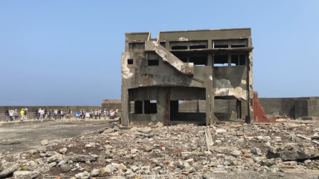 A building lies in ruins on Hashima Island on June 5 2019 near Nagasaki Japan Now a popular tourist destination Hashima Island commonly called...