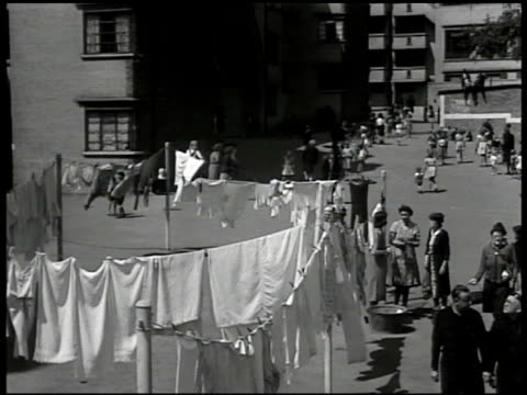 women clothesline 'i hear the government's going to keep the rationing' 'i believe in the rationing means we're all going to get a fair share in... - food stamps stock videos & royalty-free footage