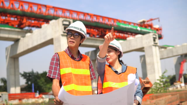 Building Manager Giving Instructions with woman engineer