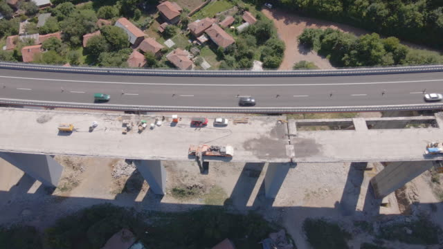 building new highways. aerial view directly above over a highway construction site, top view, cityscape. global business, construction, transport and industry. - aerial transport building stock videos & royalty-free footage