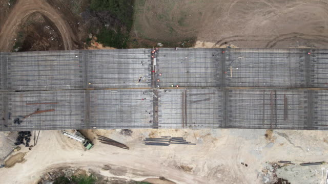 building new highways. aerial view directly above over a highway construction site, top view, cityscape. global business, construction, transport and industry. - transportation event stock videos & royalty-free footage