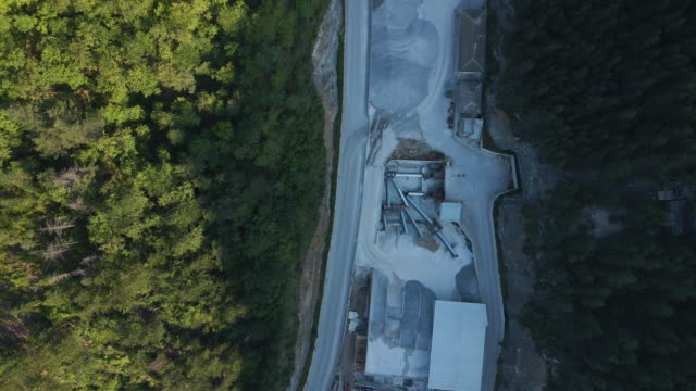 building new highways in the mountain. aerial view directly above over a highway construction site in the mountains, top view, cityscape. global business, construction, transport and industry. - transportation event stock videos & royalty-free footage
