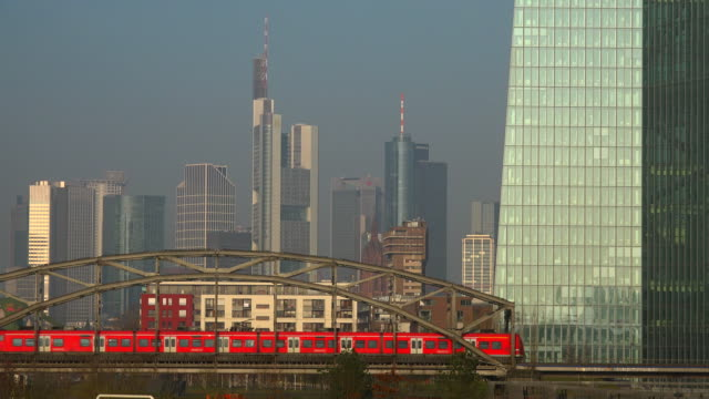 Building of the European Central Bank and skyline of Frankfurt am Main, Hesse, Germany