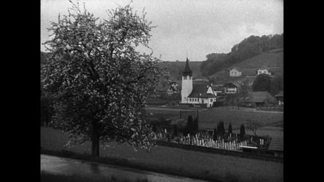 building overlooking river ws swiss landscape church building train passing ws swiss soldiers walking w/ gear vs soldiers walking up mountain hiking... - switzerland stock videos and b-roll footage