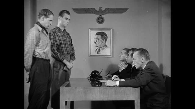 building , pedestrians, oslo int vs german nazi gestapo interviewing norwegian men, nazi eagle swastika & adolf hitler drawing bg : food ration:... - ゲシュタポ点の映像素材/bロール