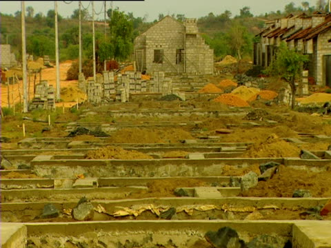 building site where foundations are being laid to rebuild houses following a tsunami in 2004 sri lanka - 2004 stock-videos und b-roll-filmmaterial