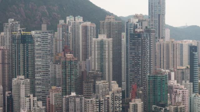 stockvideo's en b-roll-footage met 4k tl: gebouw wolkenkrabber in hong kong stad. - hong kong