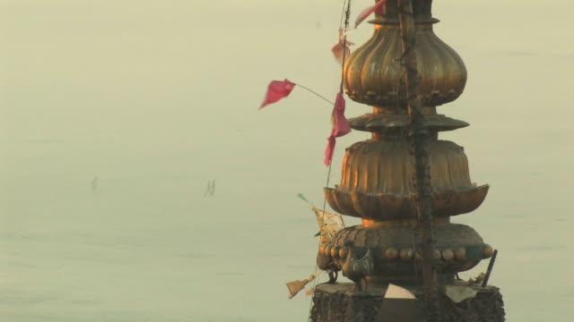 cu, building spire with flags, varanasi, uttar pradesh, india - spire stock videos & royalty-free footage