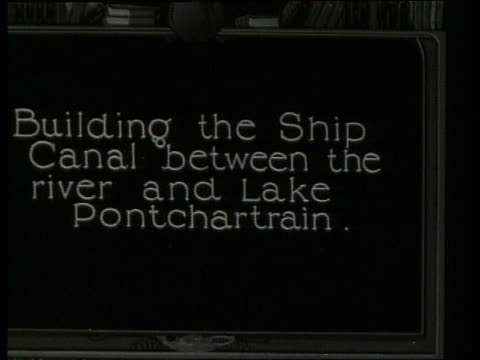"""slate """"building the ship canal between the river and..."""" / no sound - 1910 stock-videos und b-roll-filmmaterial"""