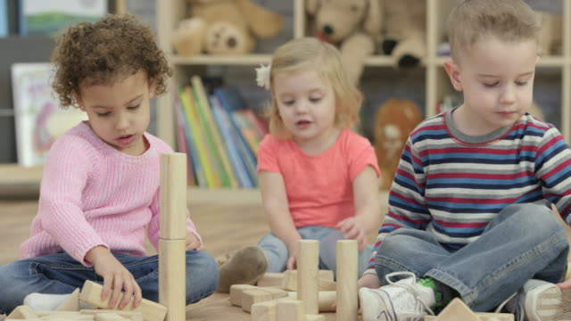 building together - nursery school child stock videos & royalty-free footage