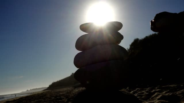 building up a stone pyramid. - bracelet stock videos and b-roll footage