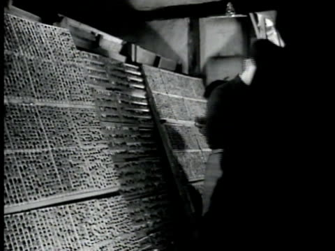 building w/ communist chinese carrying out folded paper int building w/ communist chinese men setting type ws printing press vs room w/ women folding... - folded paper stock videos and b-roll footage