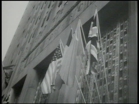 building w/ four flags of zoned germany soviet politician vyacheslav molotov walking out of door british politician ernest bevin vyacheslav molotov... - 1951 stock-videos und b-roll-filmmaterial