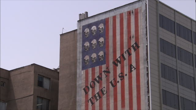 cu td tu building with anti-american mural, iran - iran stock-videos und b-roll-filmmaterial