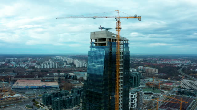 building with cranes - concrete wall stock videos & royalty-free footage