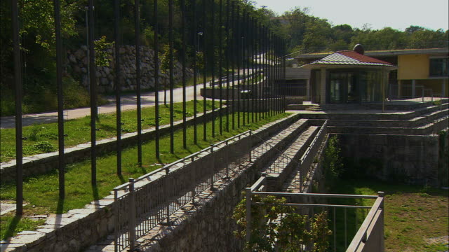 ws pan building with river sava / slovenia - wetterstation stock-videos und b-roll-filmmaterial