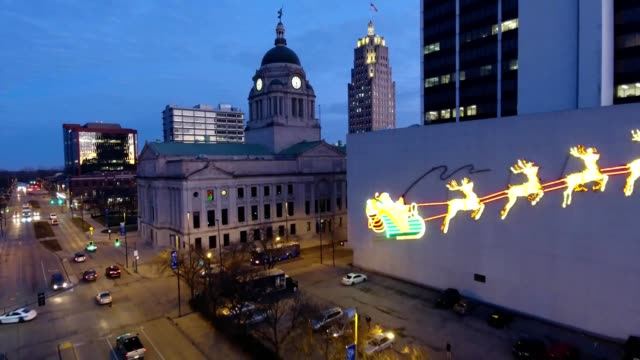 building with santa and reindeer light display and court house at street intersection - indiana stock videos & royalty-free footage