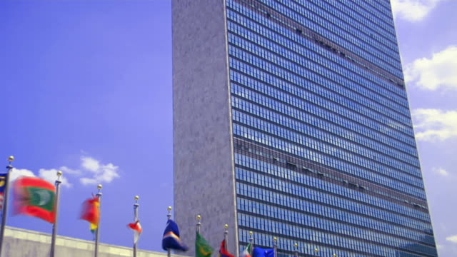 un building. zoom out - united nations building stock videos and b-roll footage