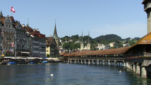 ms, zo, buildings along river reuss with chapel bridge and water tower, lucerne, switzerland - circa 14th century stock videos & royalty-free footage