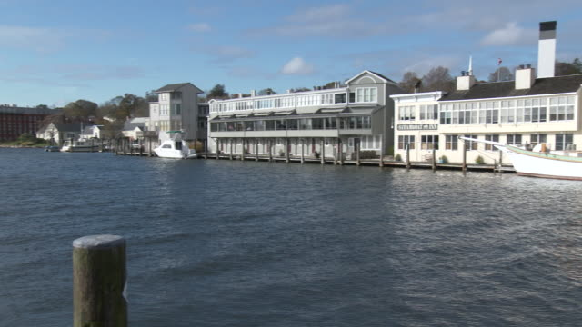 (panning shot) buildings along the mystic river waterfront, drawbridge - drawbridge stock videos and b-roll footage