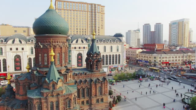 buildings and crowded people on square near harbin st. sophia cathedral 4k