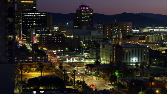 buildings and distant mountains in downtown phoenix, az at twilight - aerial view - arizona stock videos & royalty-free footage