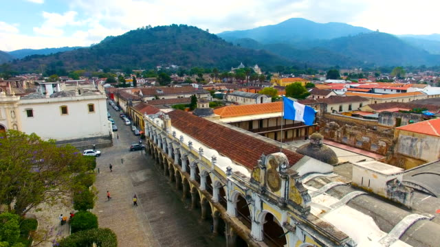 buildings and guatemalan flag in antigua - guatemala stock videos & royalty-free footage
