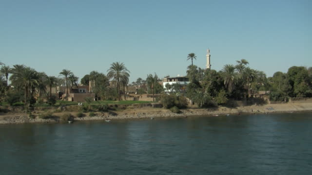 ws, pan, buildings and hills along nile river, egypt - river nile stock videos & royalty-free footage