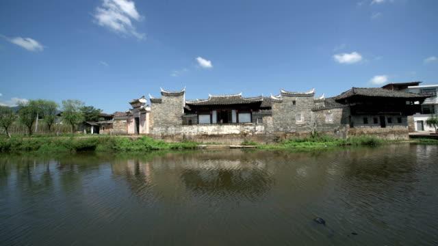 buildings and lifestyles in yiqian old town, guangchang county - れんが造りの家点の映像素材/bロール